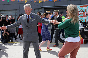 Prince Charles and Camilla finish their tour in dancing spirits